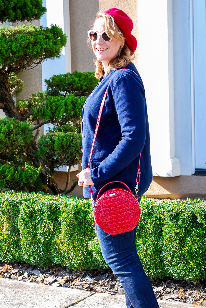 Woman wearing red beret and navy jacket with striped shirt for a red loves navy everyday chic look