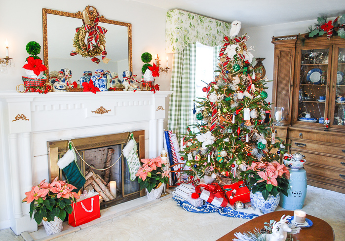 Full view of preppy and plaid Christmas tree with traditional mantel decorated with boxwood, plaid ribbon, and blue and white ceramics