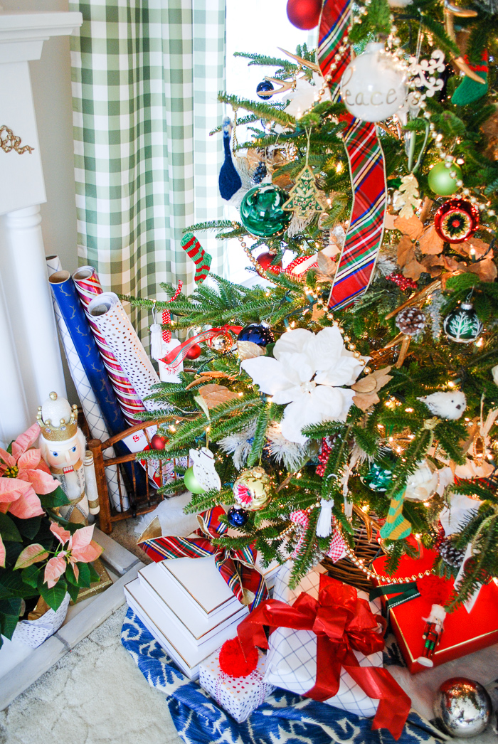 Nutcracker and bamboo basket wait by the preppy & plaid Christmas tree