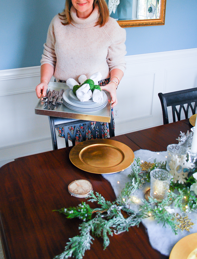 set the table in white, gold, and green for this frosted forest tablescape