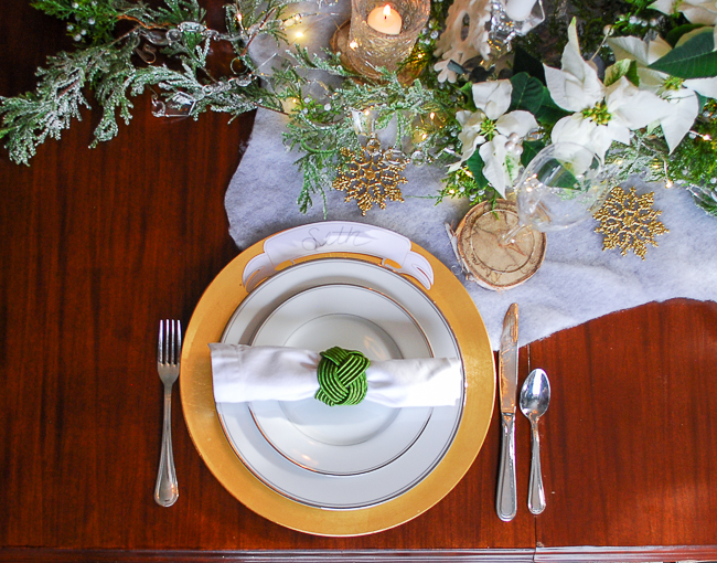 Winter tablescape tutorial - place setting in white, gold, and green