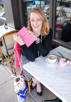 10 novels for the rosy romantic - woman at cafe reading book with latte and peonies in pearls and tweed