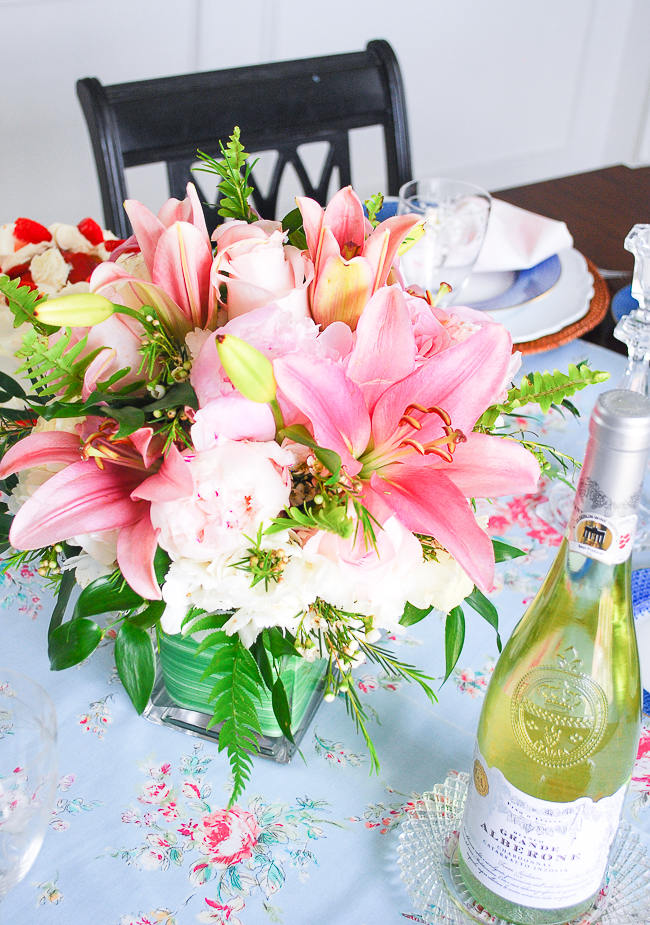 A pretty spring bouquet with pink lilies, white and pink roses, and pink peonies