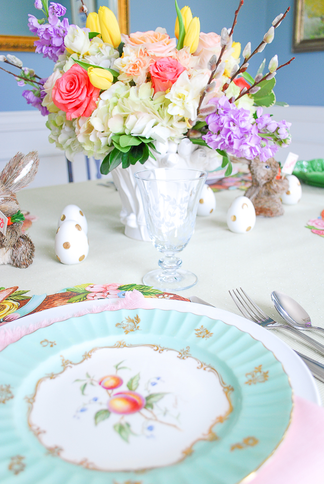 Easter brunch table place setting with Hester & Cook bunny placemats and Royal Worcester antique china and pale pink napkin