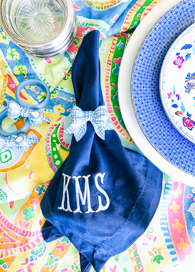 Monogram blue and white napkins add the preppy touch to this summer table