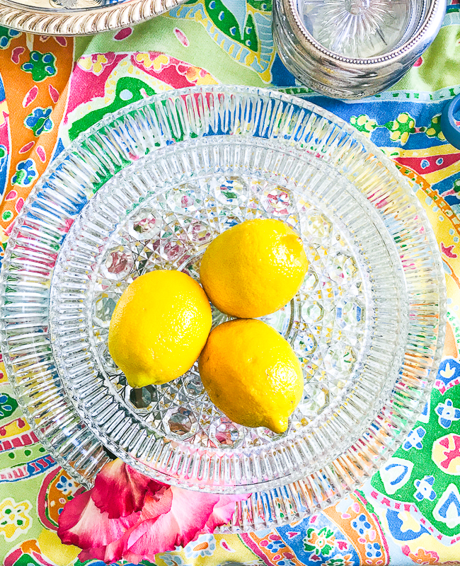 Use a fruit centerpiece like lemons in a glass bowl - 5 summer table styling tips