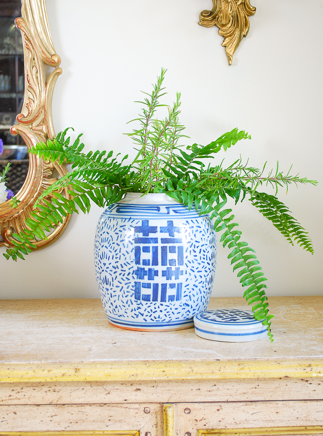 step 1 create a foundation with greenery in your ginger jar to create the perfect floral arrangement