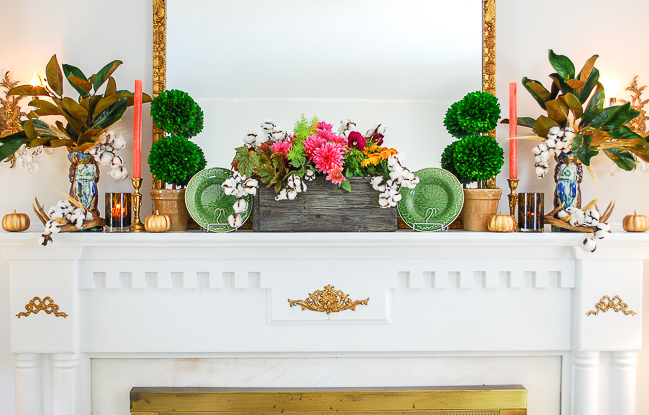 Fall dish garden centers autumn mantel with majolica plates, boxwood topiaries, and mini pumpkins