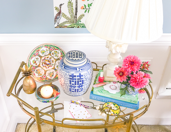 Chinoiserie look for less - ginger jar, butterfly plate, brass pineapple on bar cart