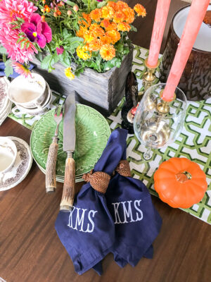 Navy monogrammed napkins add that special touch to this Southern autumn table