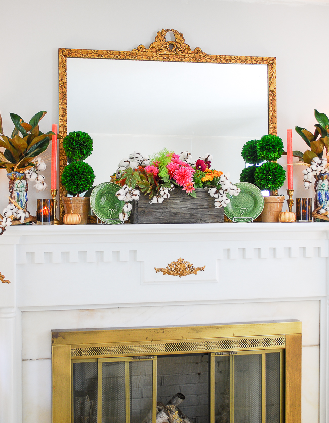 Traditional interior with chic fall mantel decor, gilt mirror, and green gingham curtains