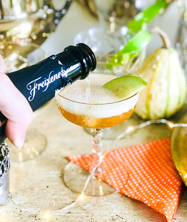 A delicious bubbly apple cocktail with apple cider and Freixenet cava bubbly.