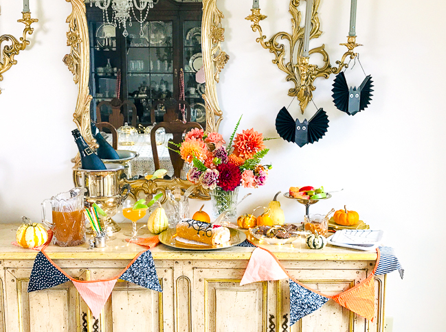 Halloween treat bar filled with yummy desserts and bootiful decor!