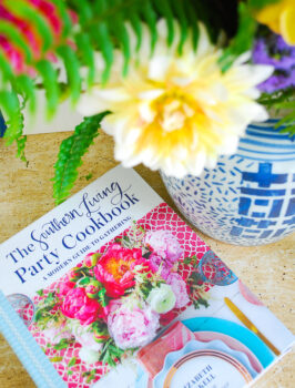 Southern Living Party Cookbook beside ginger jar vase of dahlias