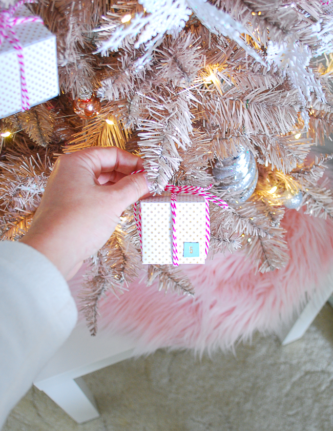 Hang DIY advent calendar mini-present ornaments on Christmas tree