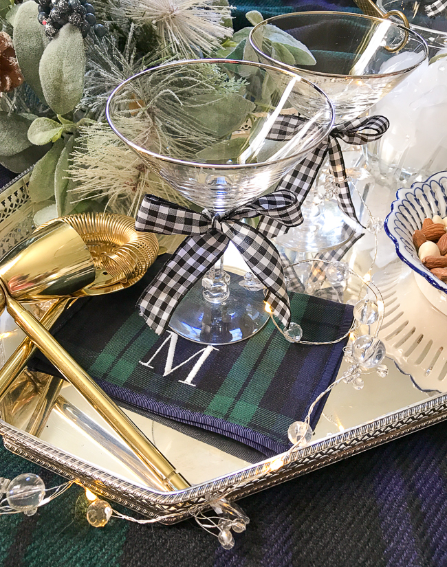 Plaid decor pairs well with gingham like in this black watch plaid cocktail napkin and gingham bow on the martini glass