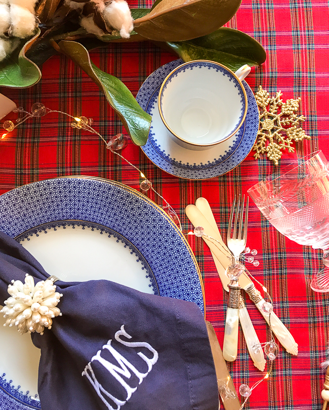 To mix plaid decor with other patterns and colors pull a minor color from the plaid to pop