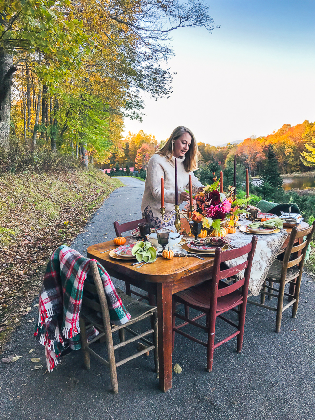 Katherine of Pender & Peony arranges florals on this Thanksgiving Table.