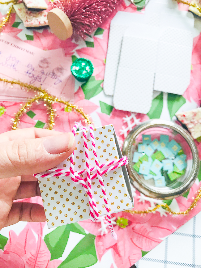 Wrap string around boxes and tie a bow on top