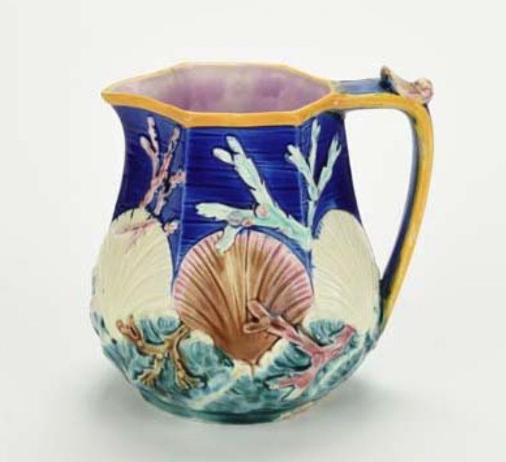 Majolica pitcher with seashells and seaweed.
