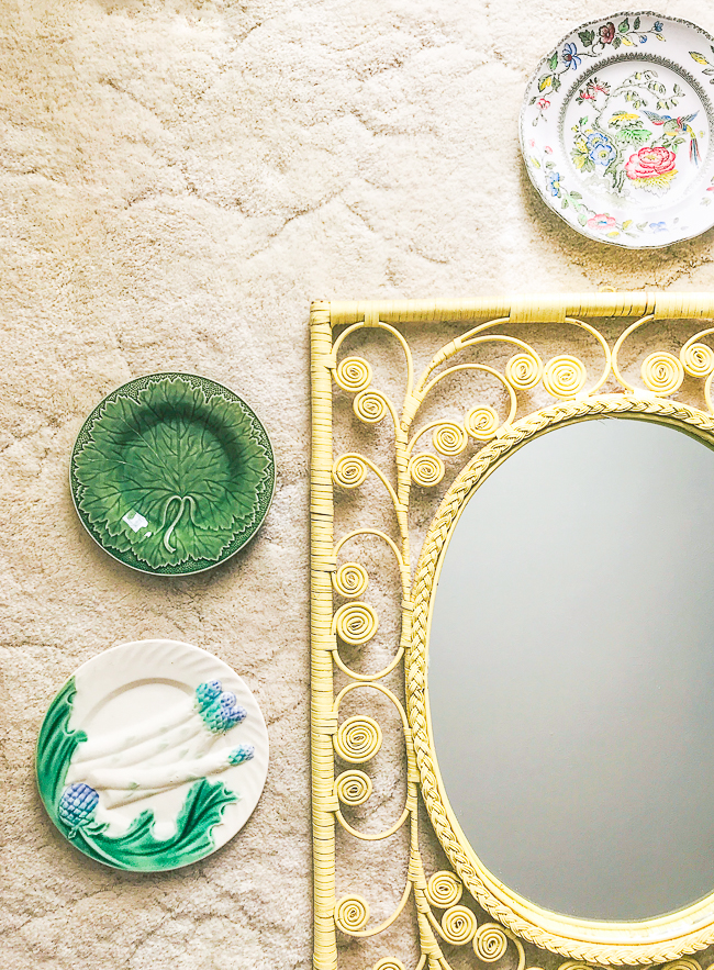 Hang Majolica plates around mirror for a playful Majolica display