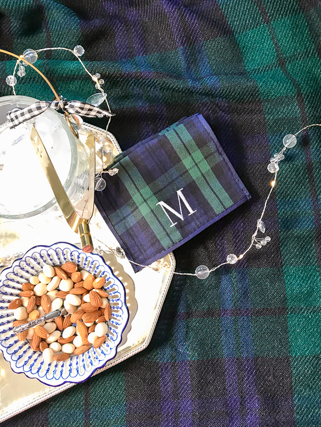 Double up on the black watch plaid decor with a cocktail napkin and tablecloth in same patter but different scales