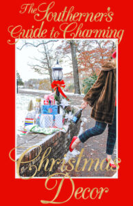 Guide to Charming Christmas Decor. Wrapped presents nestle in snow by lamp-post as Katherine dashes off in fur coat, and plaid pants with bottle of champagne