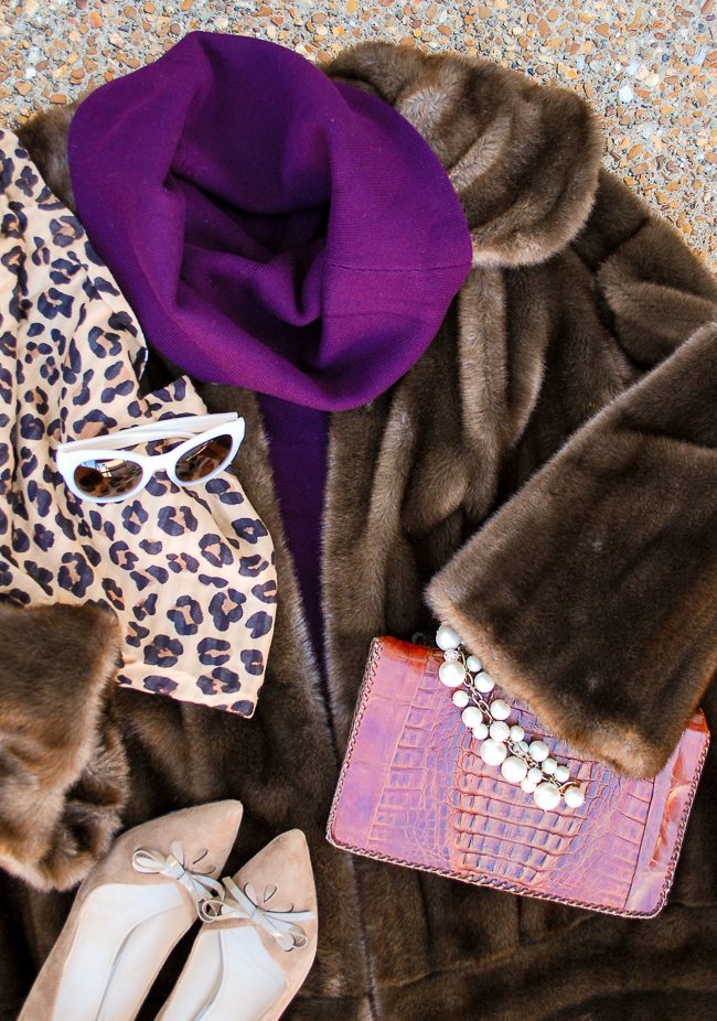 The fashion color story I'm obsessed with for fall: violet and chocolate - illustrated in this flat lay with purple sweater, fur coat, and leopard print scarf