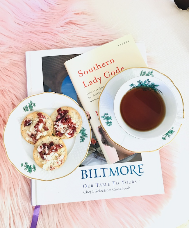 Southern Lady Code and Biltmore Cookbook with cheese and crackers and cup of tea