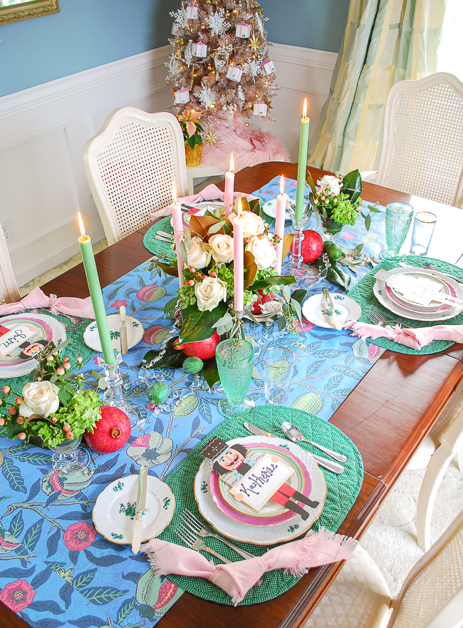 Colorful and bold Christmas tablescape with William Morris runner, pink and green china, Hester & Cook Nutcracker placards, white roses