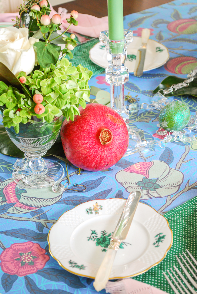 Mingle high and low on your bold holiday tablescape with fine china and a wrapping paper table-runner