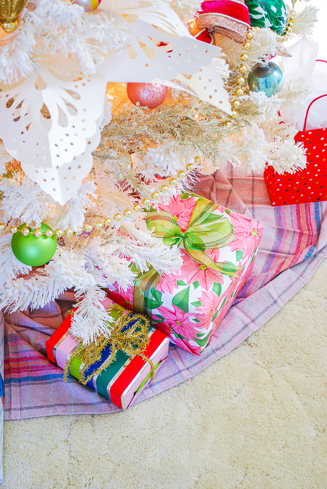 Pretty presents wrapped up and tied with bows under the Christmas tree