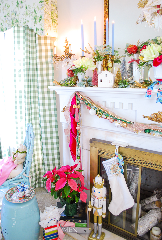 multi-strand ribbons, ornament garland, and white velvet stockings also deck this Christmas mantel