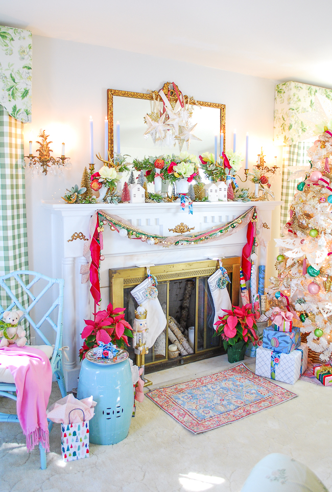 A whimsical Christmas mantel with snow village and colorful florals