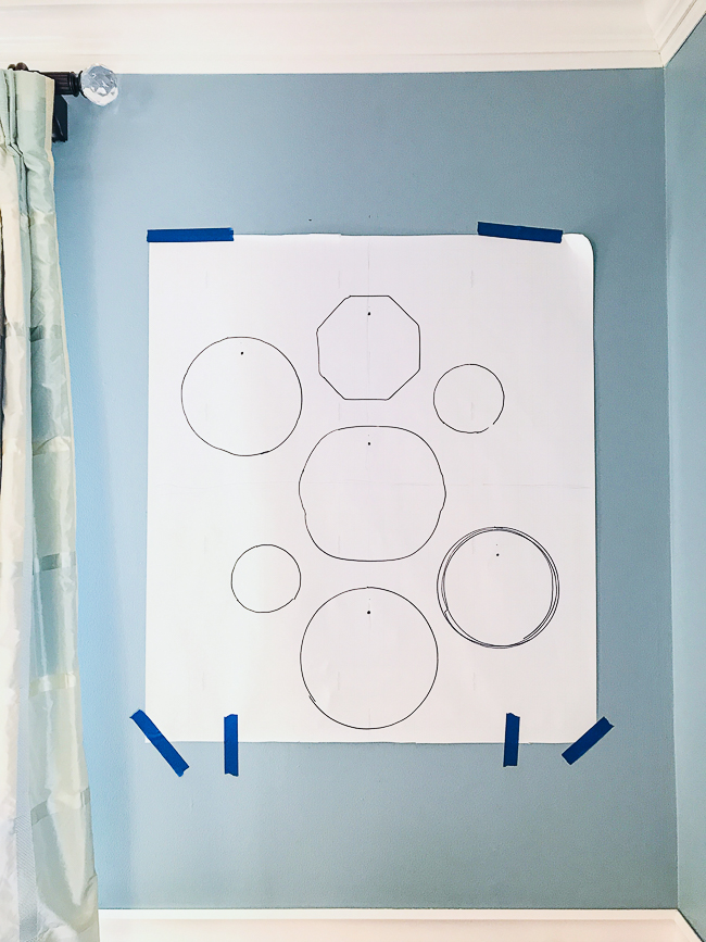 Tape paper layout template to wall