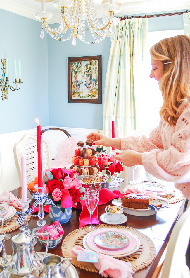 Katherine places macarons on tower for Valentine's tea centerpiece