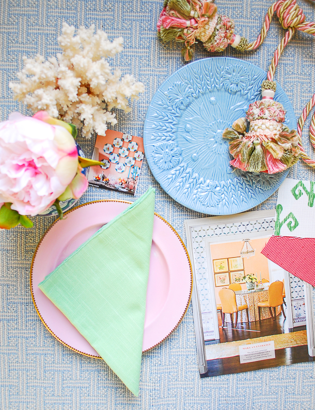 Bright pastels like this pink plate, green napkin, and colorful tassels are loved by grandmillennials