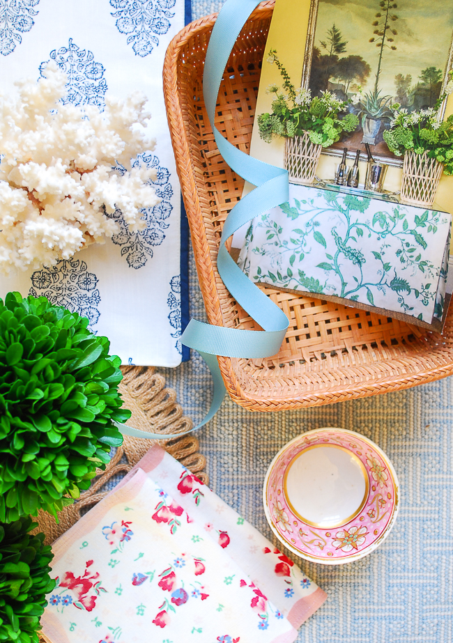 Wicker basket filled with blue ribbon and magazine clipping