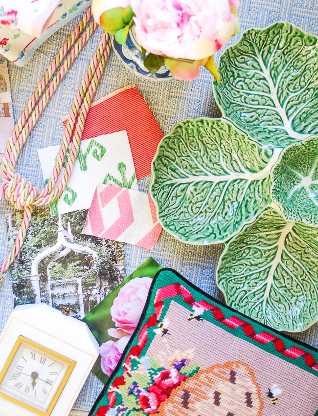 Flatlay collage with Bordallo cabbage dish, needlepoint pillow, fabric swatches, and trim