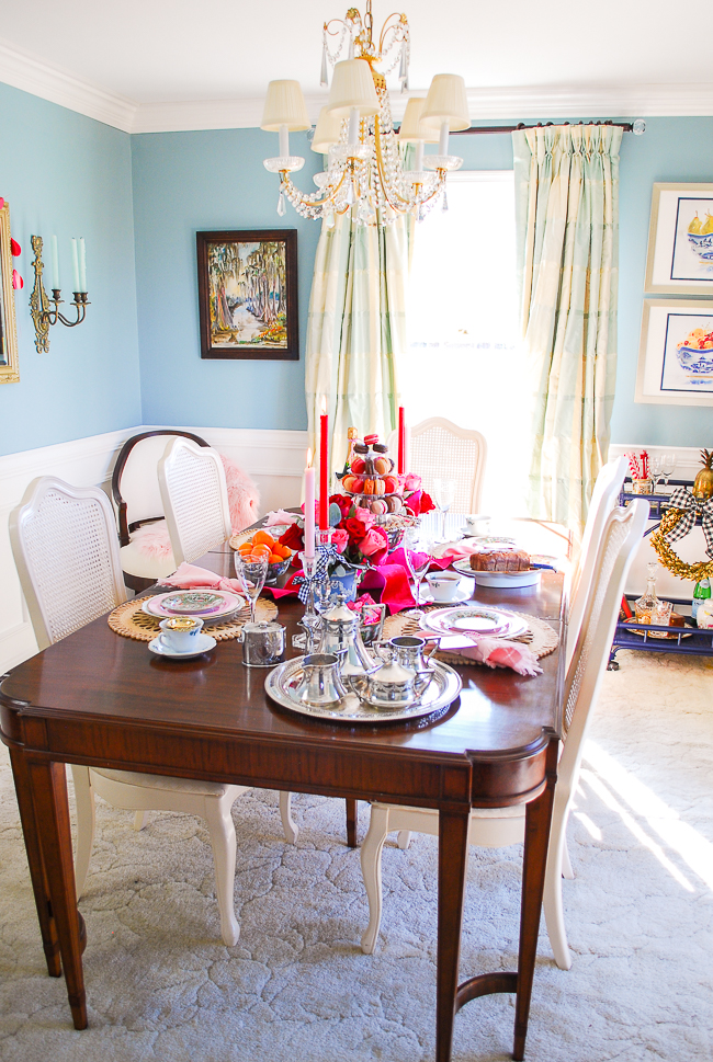 Grandmillennial dining room in pale aqua with plaid silk curtains decorated for Valentine's Day tea party with red and pink tablescape