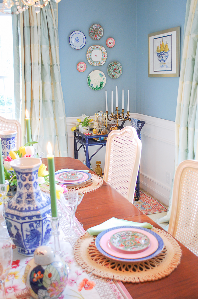 Installed plate wall in traditional dining room decorated in soothing aqua, white, plaid curtains and navy accents