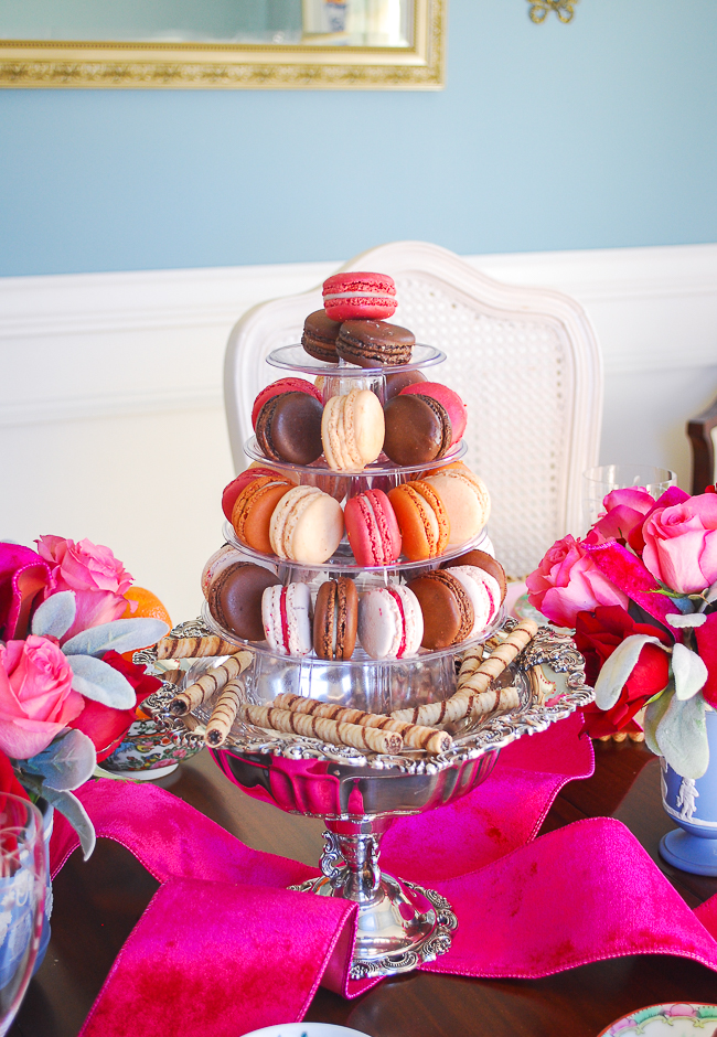 Macaron tower centerpiece in silver compote on red and pink Tea for Valentine's