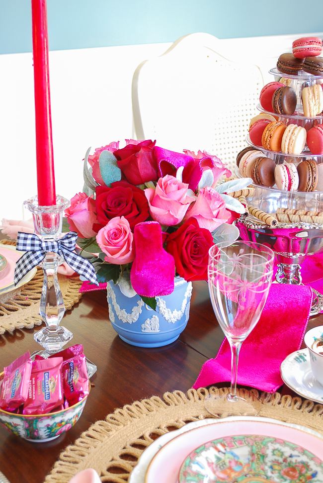 Red and pink roses arranged in blue Wedgwood vase