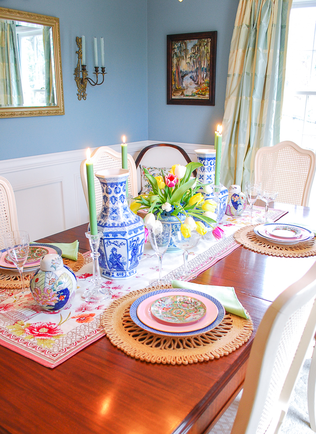 Chinoiserie tablescape with blue and white vases, tobacco leaf ginger jars, tulips, and candlelight