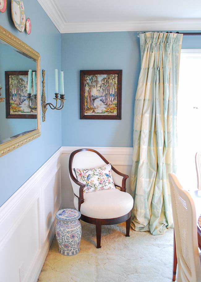 Sitting nook in traditional dining room with aqua walls, plaid curtains, and grandmillennial style