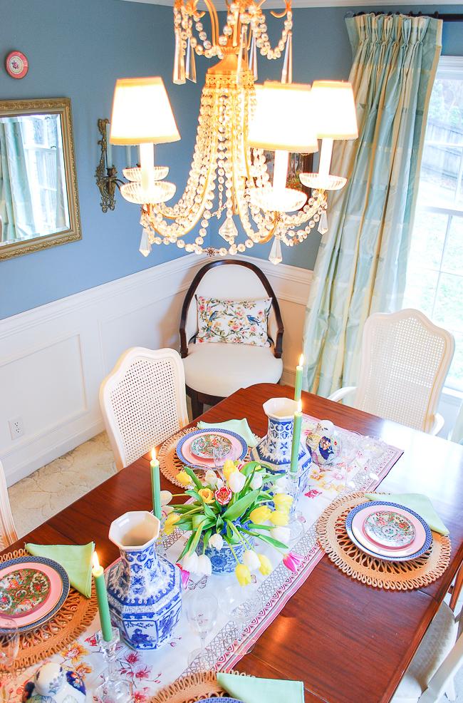 Elegant crystal chandelier in grandmillennial style dining room