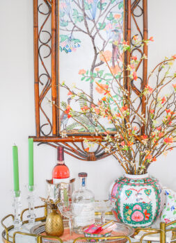 DIY Chinoiserie panel above vintage brass bar cart with rose medallion, crystal, and antique silver