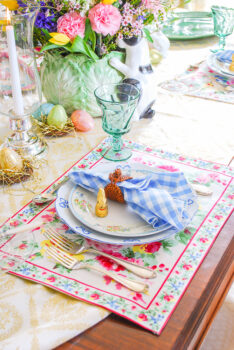 April Cornell cottage rose placemats add a colorful, bold pattern to the Easter table setting