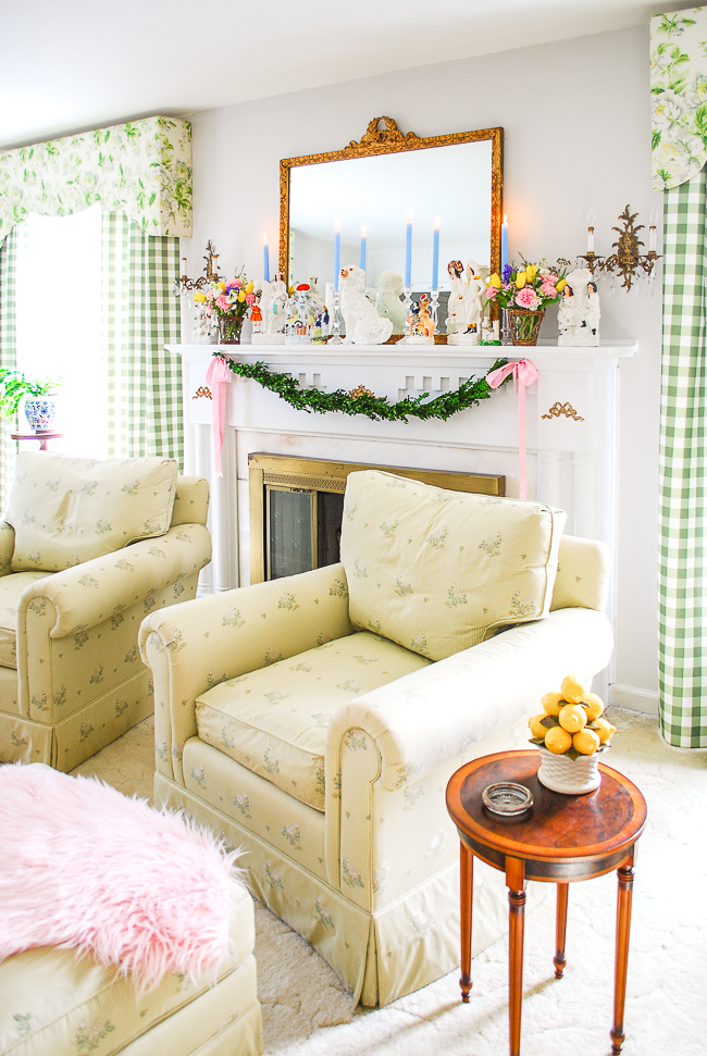 Living room decorated for spring with Staffordshire mantel and spring florals on my colorful Southern home tour