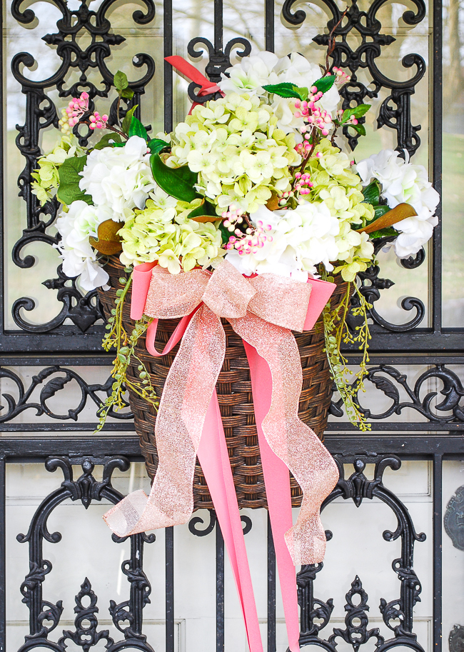 Spring flower basket for front door decoration is the first stop on my colorful Southern home tour for spring decorations